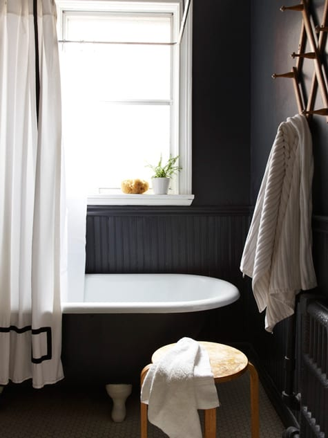 "Image above: Black can be imposing and creepy, but also calming and serene. What a perfect space for a bubbly bath. That curtain is a bit ""Psycho"" though, no?"